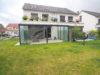 Haus-im-Haus Einheit! Moderne 3-Zimmer-Maisonette-Whg. mit Wintergarten und Garten - Rückansicht
